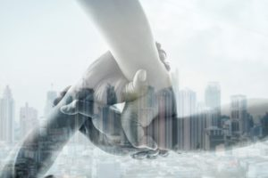 Double exposure of three hand collaboration of teamwork and city